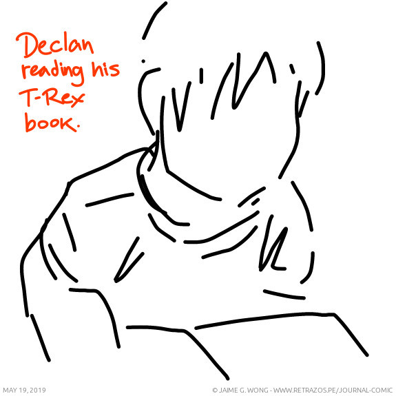 Declan reading his T-Rex book
